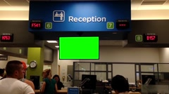 Green billboard on tv screen with line up people for applying driver license Stock Footage