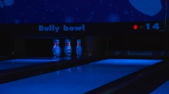 Closeup - pin strike at neon bowling Stock Footage