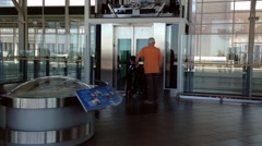 People waiting elevator at YVR airport  in Vancouver BC Canada. - stock footage