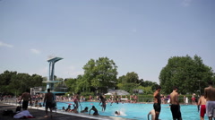 Children at the pool on a hot summer day Stock Footage