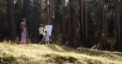 The young family draws in the wonderful wood Stock Footage