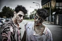 Two male zombies standing in empty city street Kuvituskuvat