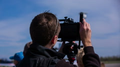 Camera man shooting an event with a video camera Stock Footage