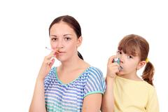 Cigarette smoking in adults can cause disease in children Stock Photos