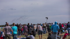 Stock Video Footage of Hundreds of people watching air show