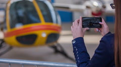 Person photographing a helicopter in hangar Stock Footage