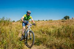 Mountain Bike cyclist riding track at sunny day, healthy lifesty - stock photo