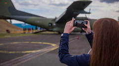 Take photo of big army bomber in background Stock Footage