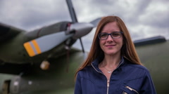 Woman pilot portrait in front of bomber plane Stock Footage