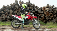 Female Biker Getting Off the Motorcycle Stock Footage