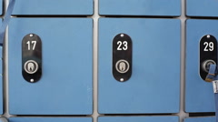 A person opens a safe locker with key, takes out wallet, close up Stock Footage