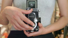 Woman uses an old vintage Yashica medium format camera, close up Stock Footage