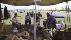 Demonstration of World war military under tent 4K Stock Footage