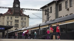 4K Tourist people travel train up rail station open door local transportation  Stock Footage