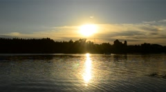 Motor boat at sunset on a river - stock footage