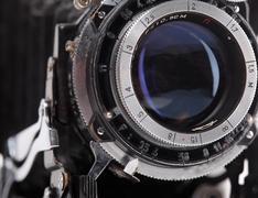Vintage photo camera lens closeup - stock photo