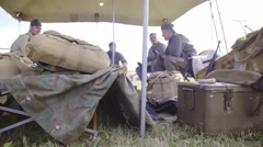 World war soldiers under tent with equipment 4K Stock Footage