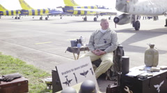 Retro pilot on airport sit surrounded with equipment 4K Stock Footage