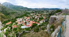 Panoramic view from fortress wall of city Bar in the foothills, Montenegro - stock photo