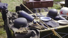 Old military equipment on table 4K Stock Footage