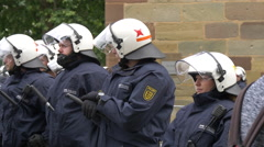 Police officers safeguard the perimeter of Gay Pride itinerary, Stuttgart Stock Footage