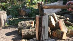 Logger Cutting Log with Axe - stock footage