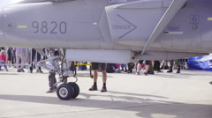 Person walk on stairs of jet combat aircraft 4K Stock Footage