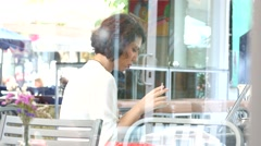 Smoking woman at street public cafe table using typing her smart phone screen Stock Footage