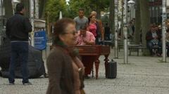 Man playing the cimbalom on Konigstrasse, Stuttgart Stock Footage
