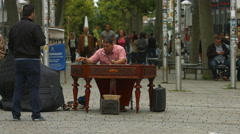 Playing the cimbalom on Konigstrasse, Stuttgart Stock Footage