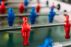 Table football game with red and blue players. Red Foosball Play Kuvituskuvat
