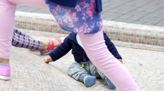 Toddler child of one year learns to crawl and to overcome hill obstacle Stock Footage