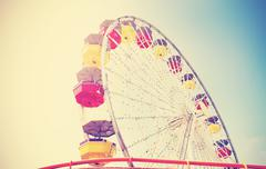 Old film retro style picture of an amusement park. - stock photo