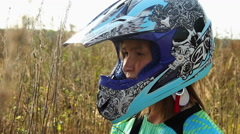 Young Woman Taking Off the Motocross Helmet Stock Footage