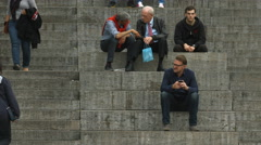 Two men talking and sitting down next to Kunstmuseum, Stuttgart Stock Footage