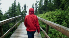 Young Woman Walking on a Boardwalk during a rainy day of Summer Stock Footage