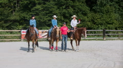 Cowgirls wining western reining competition wide shot Stock Footage