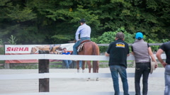 Viewers watching reining competition horse spinning Stock Footage