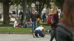 Tourists drawing with chalk on Konigstrasse, Stuttgart Stock Footage