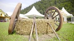 Old wooden wheels on hay slide shot 4K Stock Footage