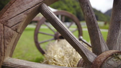 Wooden wheels lean on hay at a farm 4K Stock Footage