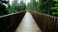 Walking POV on a Wet Boardwalk on a rainy Day - stock footage