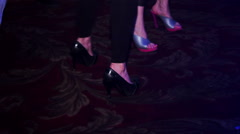 Close-up of feet, dancing on carpet in club Stock Footage