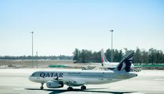 Aircraft Airbus A-320 of Qatar Airways is ready to take off from - stock photo