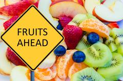 Yellow roadsign with message FRUITS AHEAD - stock photo