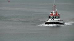 Iceland city of Reykjavik 085 pilot boat comes back from accompany cruise ship Stock Footage
