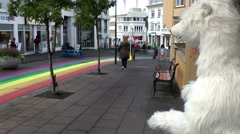 Iceland city of Reykjavik 066 ice bear looks on the rainbow colored street Stock Footage