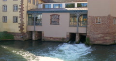 River Ill under old houses in Strasbourg Stock Footage