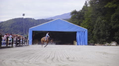 Cowgirl riding in circle inside riding arena 4K Stock Footage