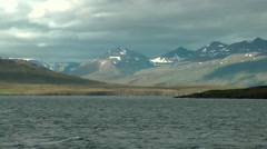 Iceland various impressions 001 rustic island shore; mountain range - stock footage